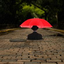 Manhole-and-Red-Umbrella